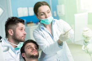Two dentists discussing treatment